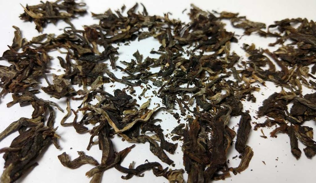 Photo of raw pu-erh leaves